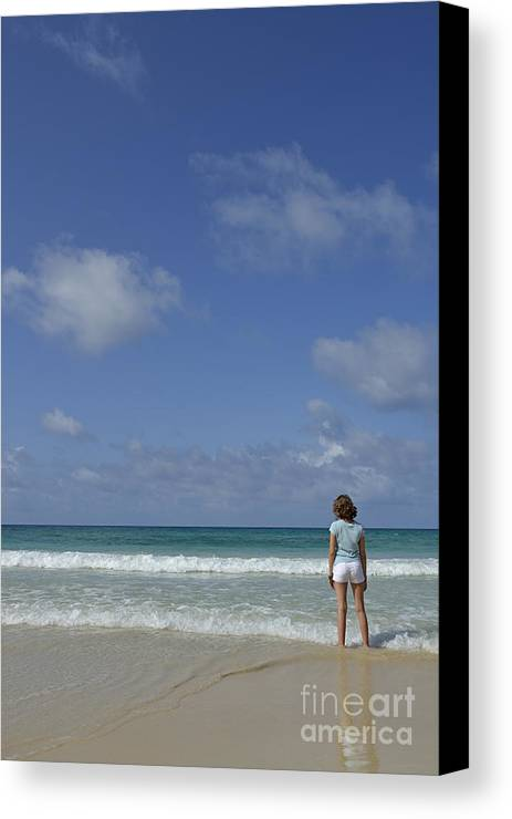 People Canvas Print featuring the photograph Girl Contemplating Ocean From Beach by Sami Sarkis