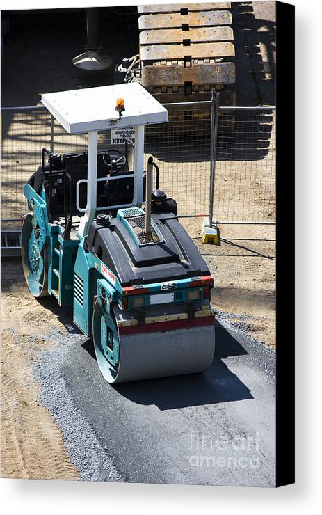 Asphalt; Bitumen; Builder; Building; Construction; Cylinder; Driveway; Equipment; Flat; Flatten; Flattener; Flattening; Gravel; Ground; Heavy; Highway; Hot; Industrial; Industry; Machine; Machinery; Metal; Outdoors; Pavement; Paver; Paving; Preparation; Pressure; Repair; Resurface; Resurfacing; Road; Roadwork; Roadworks; Roll; Roller; Smooth; Smoothing; Steam; Steamroller; Street; Surface; Surfacing; Transport; Transportation; Vehicle; Wheel; Work; Working; Works; Canvas Print featuring the photograph Road Roller by Jorgo Photography - Wall Art Gallery