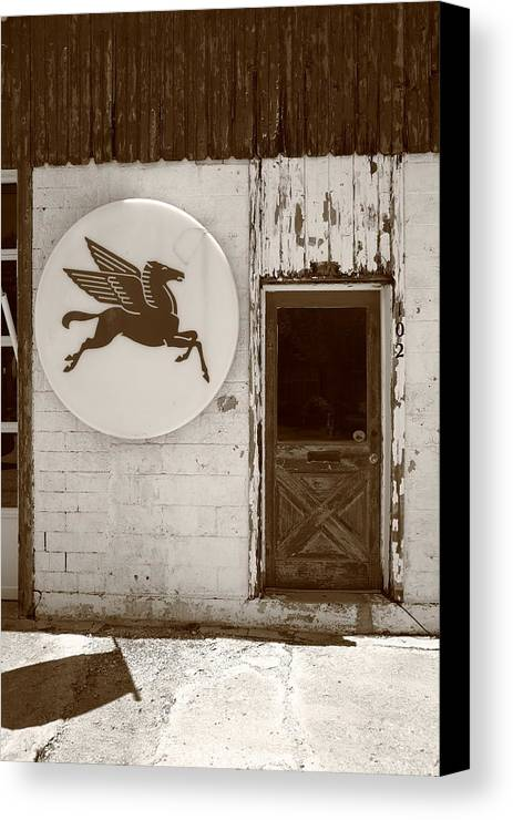 66 Canvas Print featuring the photograph Route 66 - Rusty Mobil Station by Frank Romeo