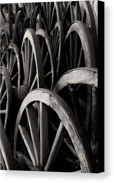Wagon Wheels Canvas Print featuring the photograph Wagon Wheels by John Nelson