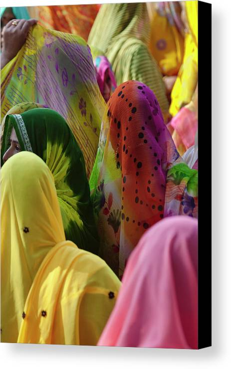 Asia Canvas Print featuring the photograph Women In Colorful Saris Gather by Keren Su