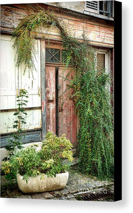 France Canvas Print featuring the photograph A Very Old Door by Olivier Le Queinec