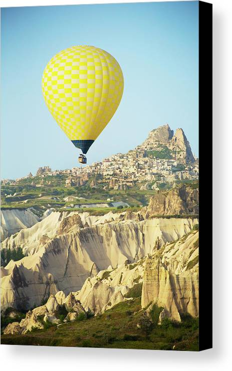 Balloon Ride Canvas Print featuring the photograph Balloon Ride Over Goreme National Park by Ron Dahlquist