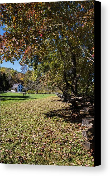 Cades Cove Canvas Print featuring the photograph Cades Cove House And Fall Colors by Kathy Clark