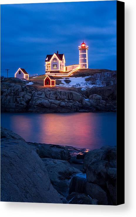 Christmas Canvas Print featuring the photograph Christmas Time At Nubble Light. by Jeff Sinon