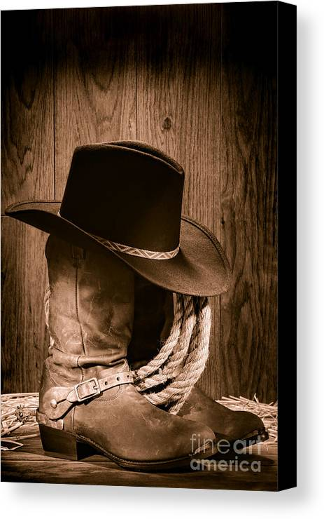Boots Canvas Print featuring the photograph Cowboy Hat And Boots by Olivier Le Queinec