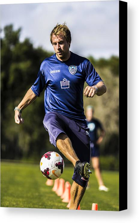 Football (european) Canvas Print featuring the photograph Fancy Footwork by Stephen Brown