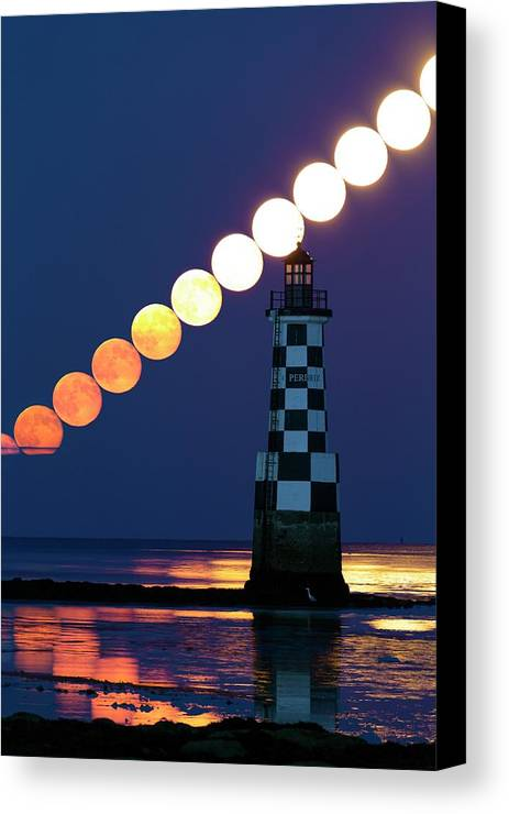 Perdrix Lighthouse Canvas Print featuring the photograph Full Moon Rising Over Lighthouse by Laurent Laveder