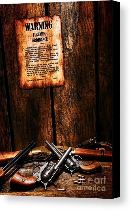 Western Canvas Print featuring the photograph Gun Control by Olivier Le Queinec