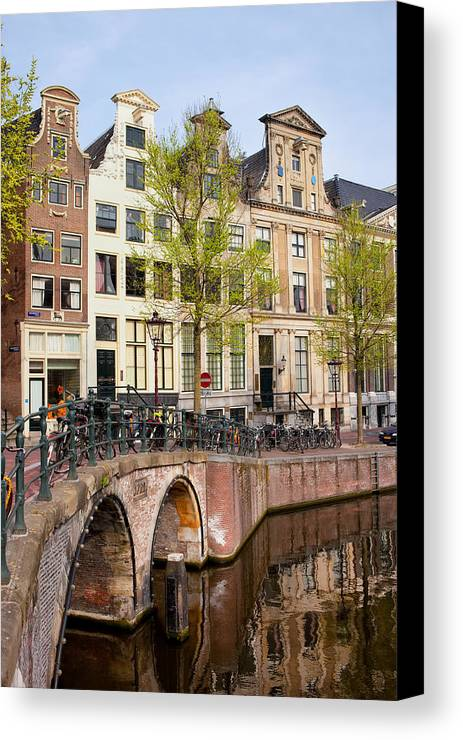Amsterdam Canvas Print featuring the photograph Herengracht Canal Houses In Amsterdam by Artur Bogacki