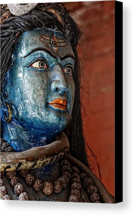 Portrait Canvas Print featuring the photograph Hindugod by Rene Schuiling
