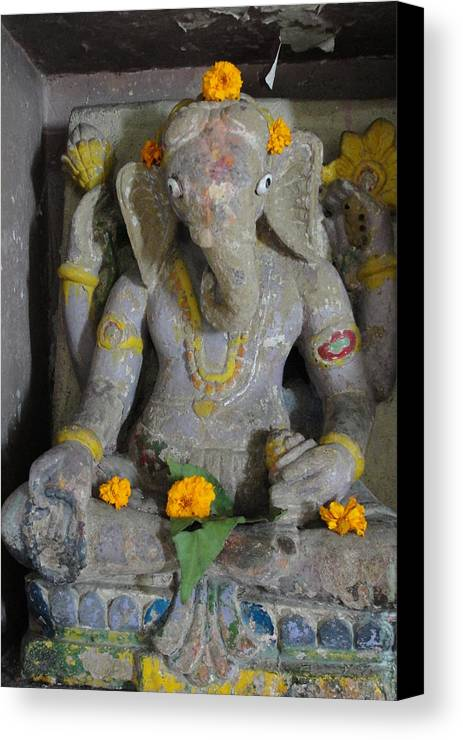 Lord Ganesha At Shiv Temple Canvas Print featuring the sculpture Lord Ganesha by Makarand Kapare