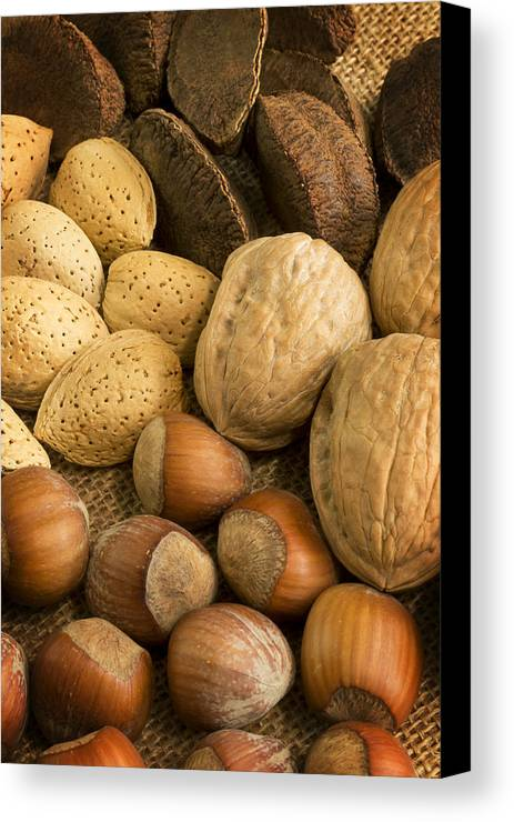 Nuts Canvas Print featuring the photograph Nuts On Burlap by Mark McKinney