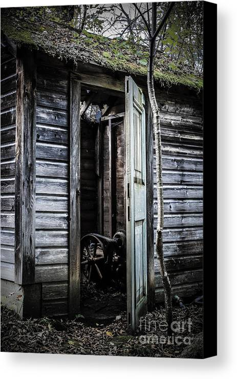 Sinister Canvas Print featuring the photograph Old Abandoned Well House With Door Ajar by Edward Fielding