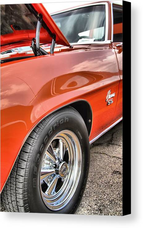 Orange Chevelle Ss 396 Canvas Print featuring the photograph Orange Chevelle Ss 396 by Dan Sproul