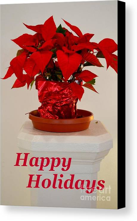 Poinsettia Canvas Print featuring the photograph Poinsettia On A Pedestal - No 2 by Mary Deal