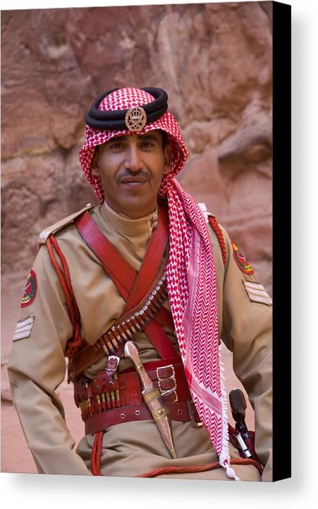 Jordanian Canvas Print featuring the photograph Policeman In Petra Jordan by David Smith
