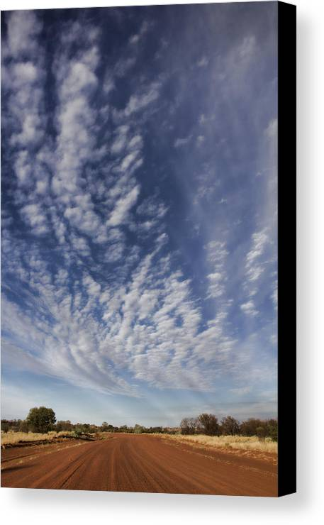Dirt Road Canvas Print featuring the photograph Red Center Road by Douglas Barnard