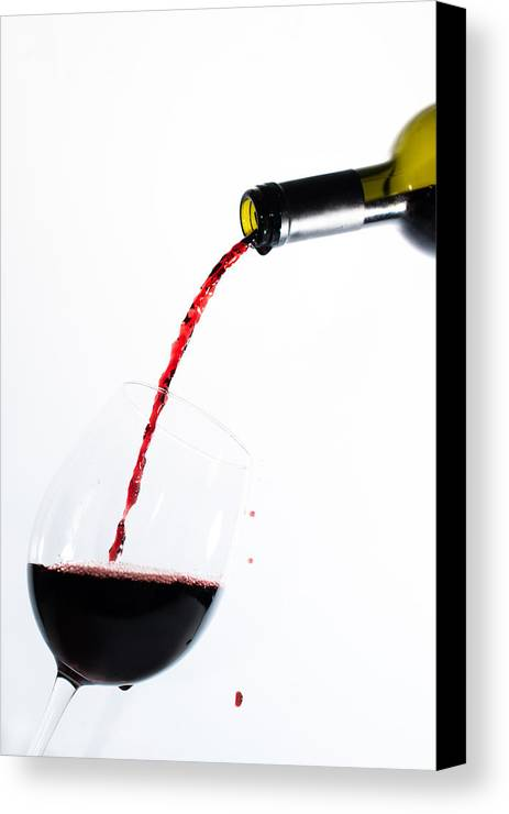 Glass Canvas Print featuring the photograph Red Wine Pouring Into A Glass by Frank Gaertner