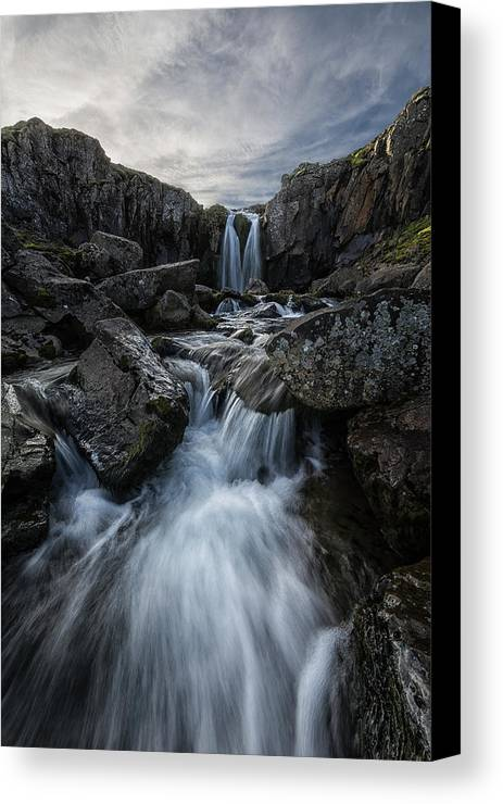 Rugged Canvas Print featuring the photograph Stream Flows Over A Waterfall by Robert Postma
