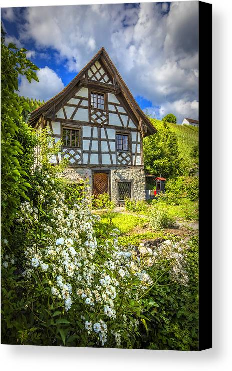 Austria Canvas Print featuring the photograph Swiss Chalet In The Garden by Debra and Dave Vanderlaan