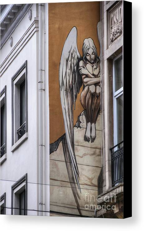 Architectural Feature Canvas Print featuring the photograph The Angel by Juli Scalzi