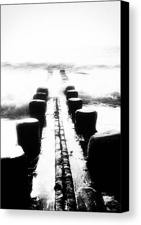 Black Canvas Print featuring the photograph The Pier by BUD LaROSA