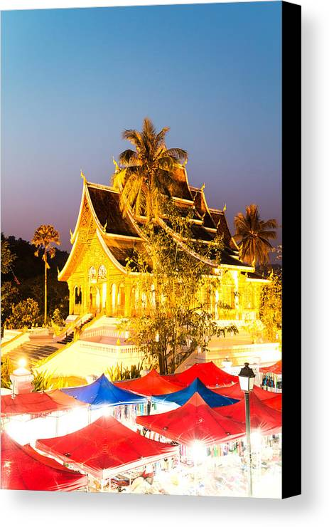Laos Canvas Print featuring the photograph Wat Mai Temple And Night Market - Luang Prabang - Laos by Matteo Colombo