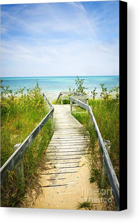 Beach Canvas Print featuring the photograph Wooden Walkway Over Dunes At Beach by Elena Elisseeva