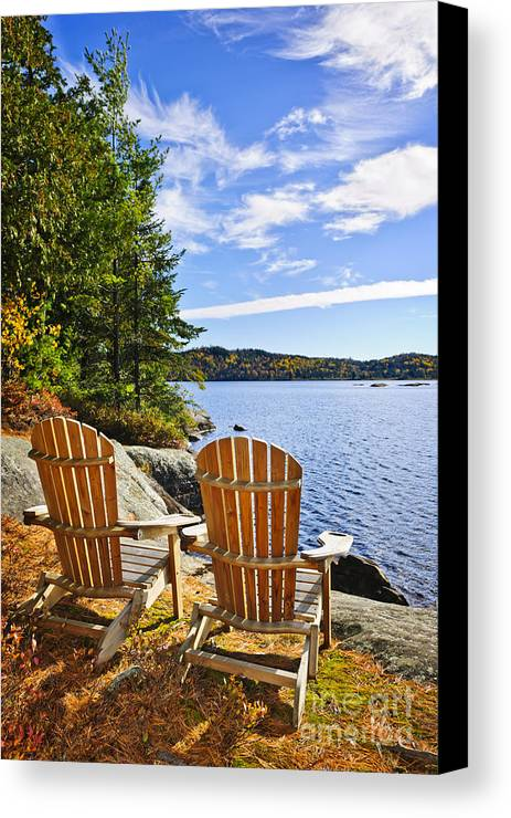 Chairs Canvas Print featuring the photograph Adirondack Chairs At Lake Shore by Elena Elisseeva