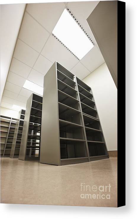 Architecture Canvas Print featuring the photograph Empty Metal Shelves by Jetta Productions, Inc