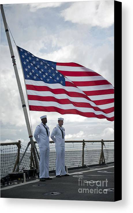 Uss Pearl Harbor Canvas Print featuring the photograph Sailors Stand At Parade Rest by Stocktrek Images