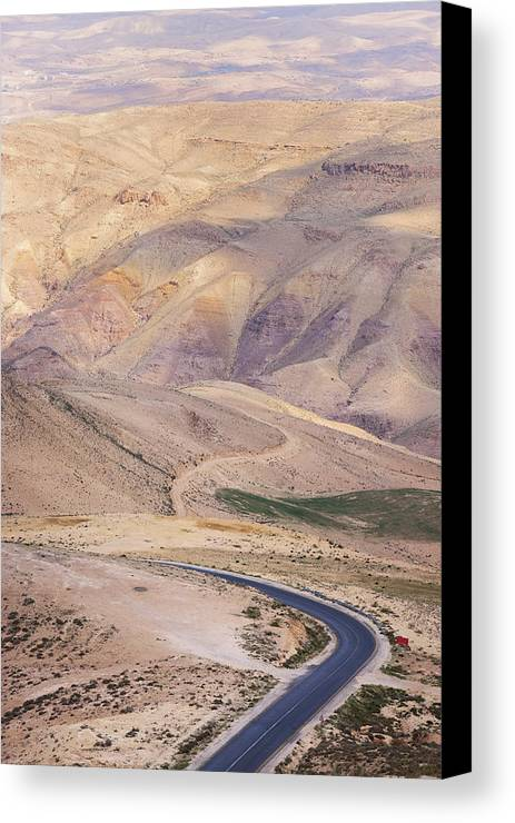Vertical Canvas Print featuring the photograph A Bend In A Desert Road Near Mount Nebo by Martin Child