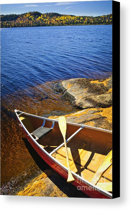 Canoe Canvas Print featuring the photograph Canoe On Shore by Elena Elisseeva