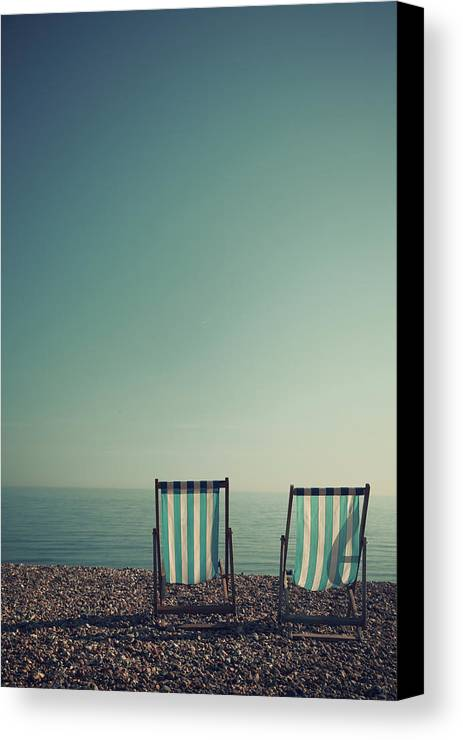 Vertical Canvas Print featuring the photograph Deck Chairs On Brighton Beach by Paul Grand Image