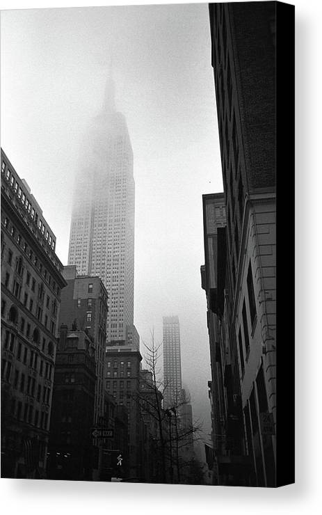 Vertical Canvas Print featuring the photograph Empire State Building In Fog by Adam Garelick
