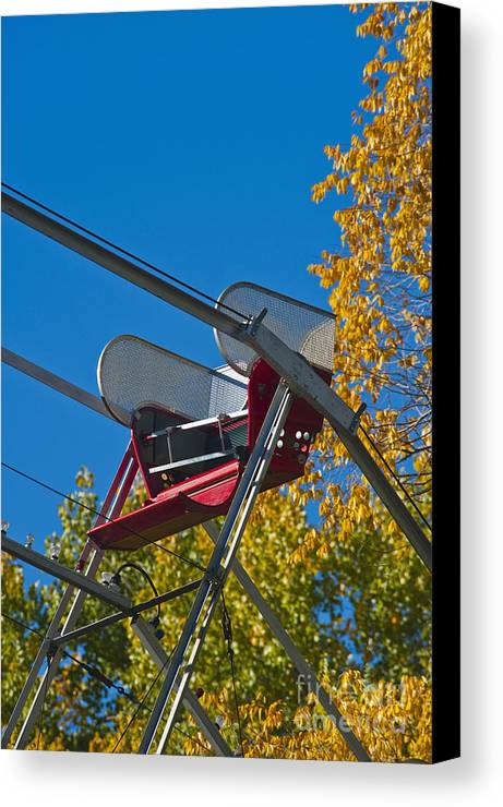 Amusement Canvas Print featuring the photograph Empty Chair On Ferris Wheel by Thom Gourley/Flatbread Images, LLC