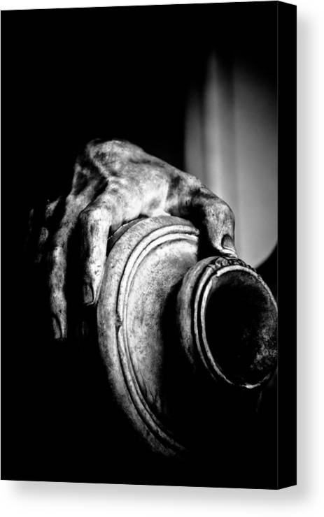 Black Canvas Print featuring the photograph Hand And Vessel by Hakon Soreide