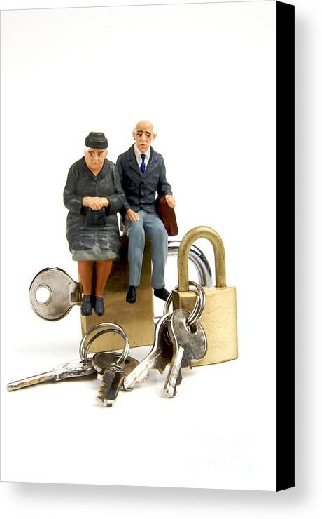Ups Canvas Print featuring the photograph Miniature Figurines Of Elderly Couple Sitting On Padlocks by Bernard Jaubert