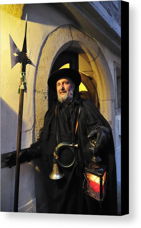 Night Watchman Canvas Print featuring the photograph Night Watchman In Old Historic Town by Matthias Hauser