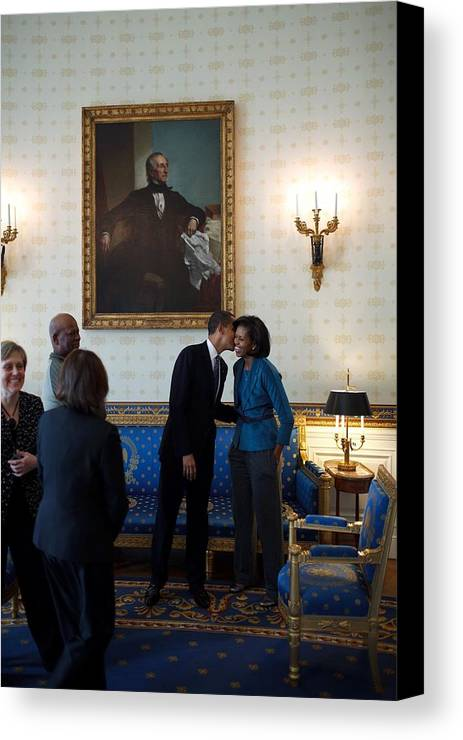 History Canvas Print featuring the photograph President Obama Kisses First Lady by Everett