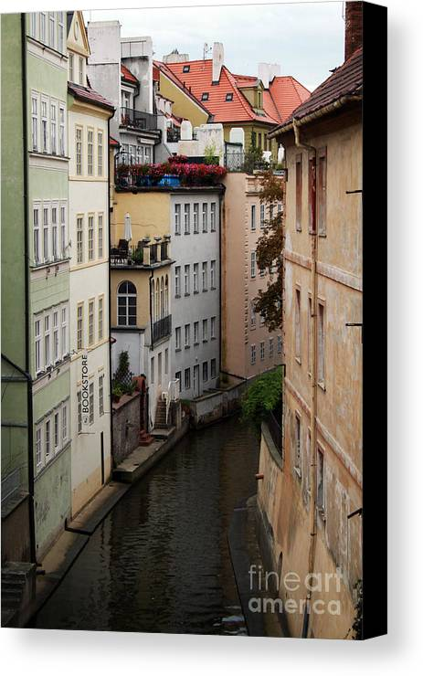 Prague Canvas Print featuring the photograph Red Rooftops In Prague Canal by Linda Woods