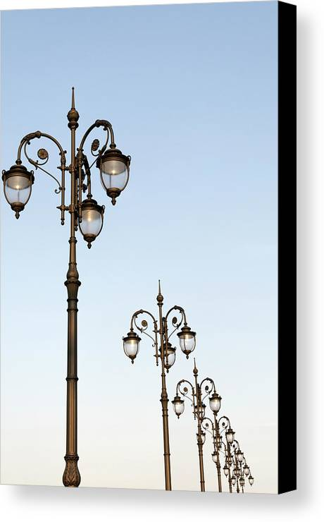 Vertical Canvas Print featuring the photograph Row Of Fancy Street Lamps by Travelif
