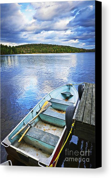 Rowboat Canvas Print featuring the photograph Rowboat Docked On Lake by Elena Elisseeva