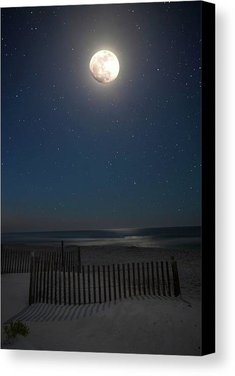 Moon Canvas Print featuring the photograph Seaside Moonset by Charles Warren