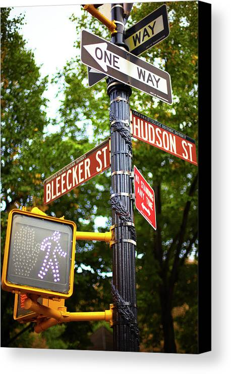 Vertical Canvas Print featuring the photograph Street Signs In Nyc by Thomas Northcut