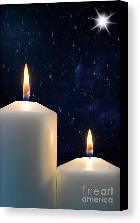 Canvas Print featuring the photograph Two Candles With Star Of Bethlehem by Michael Gray