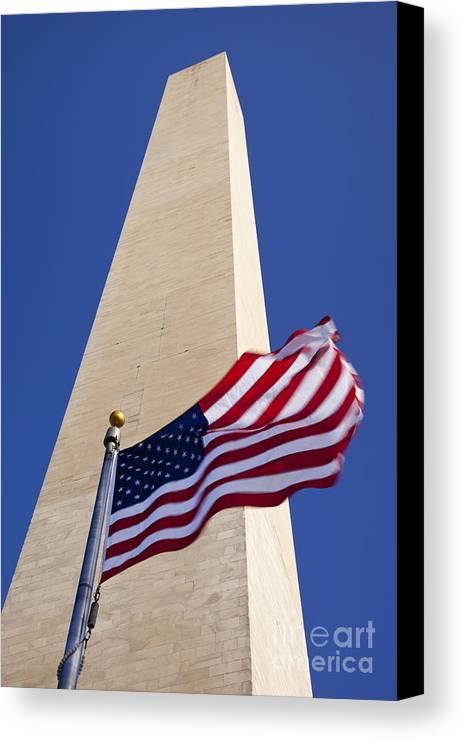 American Flag Canvas Print featuring the photograph Washington Monument Flag by Brian Jannsen