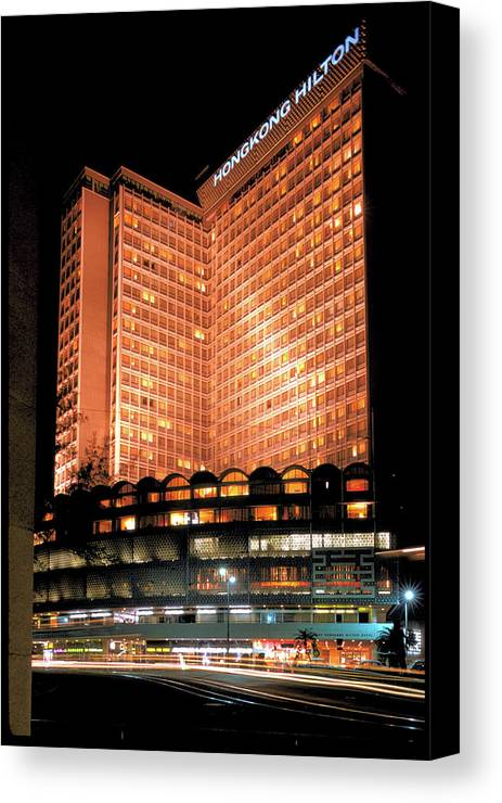 Hilton Hotel Canvas Print featuring the photograph View Of Hong Kong Hilton At Night by Carl Purcell
