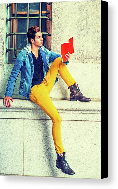Young Canvas Print featuring the photograph Young Man Reading Red Book, Sitting On Street by Alexander Image